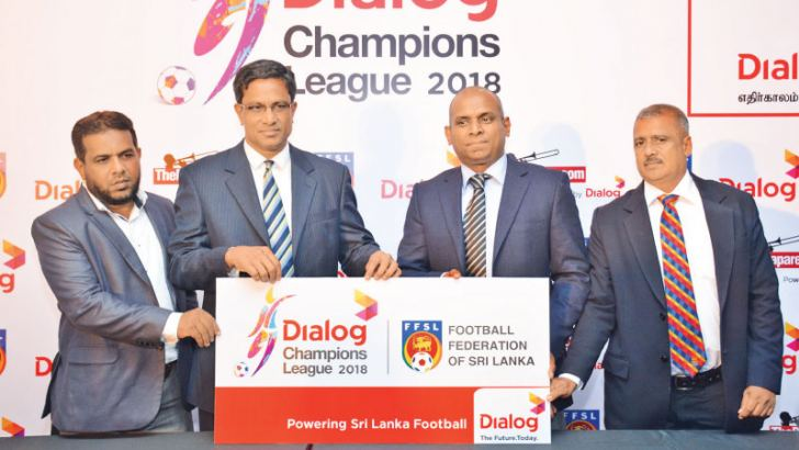 President of FFSL Anura de Silva receives the sponsorship cheque from Dimuthu Cooray, General Manager Broadband Dialog Axiata. Zaran Sinhawansa, tournament director is also present. Picture by Ranjith Asanka