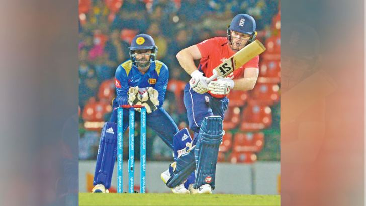 Wicket-keeper Niroshan Dickwella watches Eoin Morgan play a shot for runs during the third ODI played at the Pallekele International Stadium on Wednesday. The England captain scored an unbeaten half-century to guide his team to victory by seven wickets over Sri Lanka. - AFP