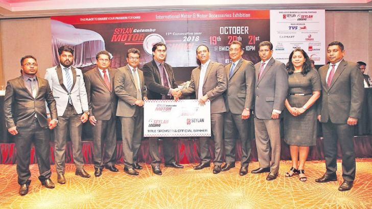 Delvin Perera, Deputy General Manager of Consumer Finance Unit at Seylan Bank, exchanging the sponsorship with Tyronne Chandrasekera, Chairman and  Managing Director of Asia Exhibition and Conventions, flanked by Seylan Bank officials' and Asia Exhibition and Conventions Officials.