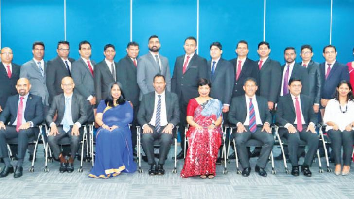 AIA's certified trainers with AIA Deputy CEO and Chief Agency Officer Upul Wijesinghe, members of AIA's Executive Committee, HR team, Training team and City & Guilds Quality assurance officer Anton Thevathasan and Managing Director DAASH Global Harshana Dassanayake.