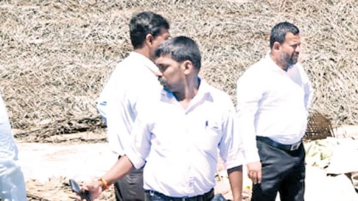 Minister of Industry and Commerce Rishad Bathiudeen inspects the doomed Paranthan Chemical Company factory site on October 19 in Paranthan.