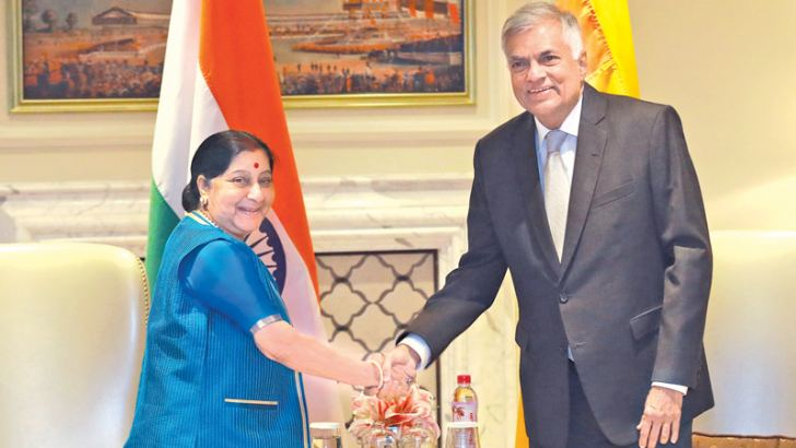 Prime Minister Ranil Wickremesinghe and Indian Foreign Minister Sushma Swaraj, in New Delhi on Saturday.