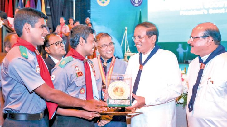President Maithripala Sirisena receives an honorary award from scouts at the President's Scout Awards 2014–2018 ceremony held at the Cooperative Institute in Polgolla, on Saturday.