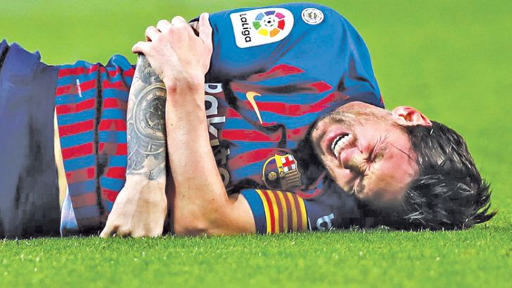 Lionel Messi in agony after fracturing his right arm.