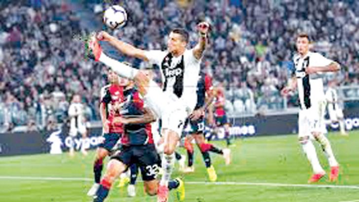 Juventus' Cristiano Ronaldo in action v Genoa at Allianz Stadium in Turin.