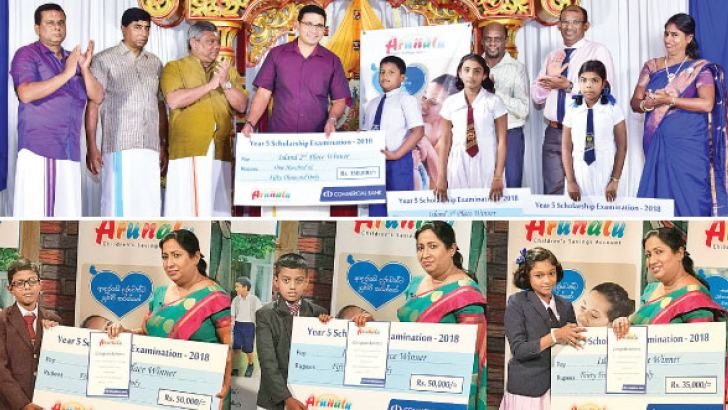 Sanath Manatunge, Commercial Bank's Chief Operating Officer presenting cash prizes at the event held in Jaffna. Dharshanie Perera, Commercial Bank's Assistant General Manager Personal Banking III presenting the cash prizes at the event at ITN