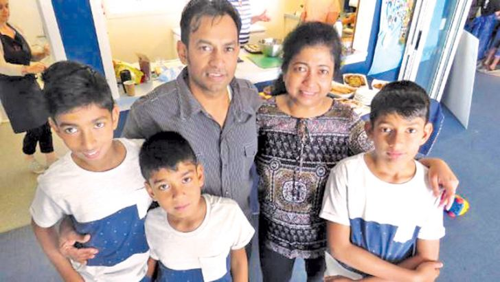 Sam and Dinesha Wijerathne with their children.