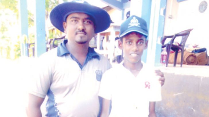 Fine fast bowler and batsman R. A. Kavindu Sathsara with his coach Dhanushka Ranmuthu at Wadduwa Central Playground.