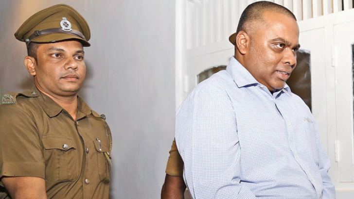 Former TID DIG Nalaka de Silva who was arrested by the CID last night being led out of Court. Picture by Rukmal Gamage