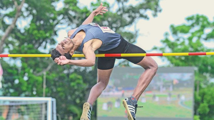 High jumper Tharindu Dasun on his way to a record.  Picture by Ranjith Asanka