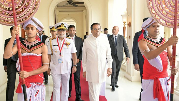 President Maithripala Sirisena arrives for the inauguration of the conference.