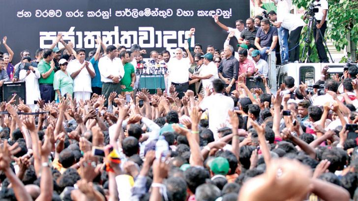 The UNP Leader and UNP MPs during the protest rally held in Colombo yesterday.Picture by Samantha Weerasiri