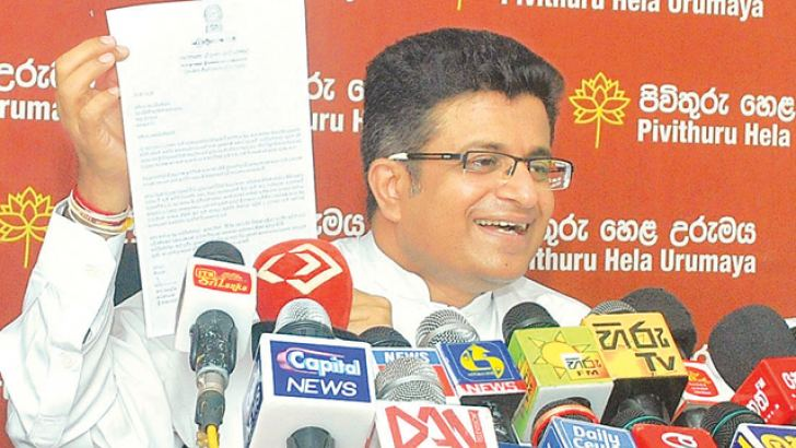 PHU Leader Udaya Gammanpila showing the Constitution during the press conference. Picture by Siripala Halwala.
