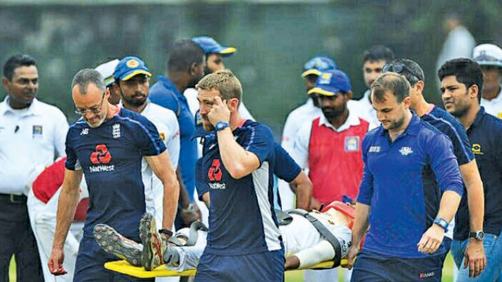 Sri Lanka Board XI cricketer Pathum Nissanka is stretchered off from the ground by medical staff of Sri Lanka and England team, after he was hit a blow on the head while fielding.