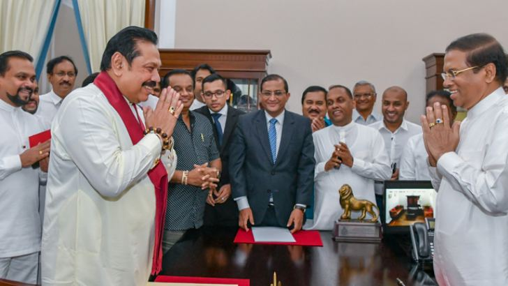 Former President Mahinda Rajapaksa was sworn in as the new Prime Minister of the Democratic Socialist Republic of Sri Lanka before President Maithripala Sirisena at the Presidential Secretariat on October 26. Picture by Sudath Silva