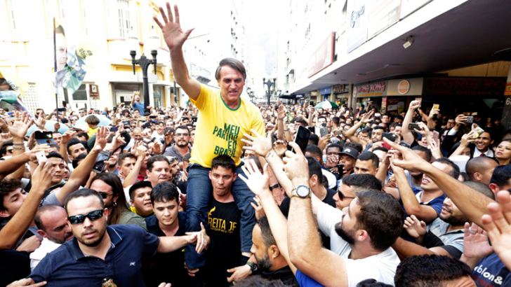 Brazil's President-elect Jair Bolsonaro is taken on the shoulders of a supporter during a campaign rally.