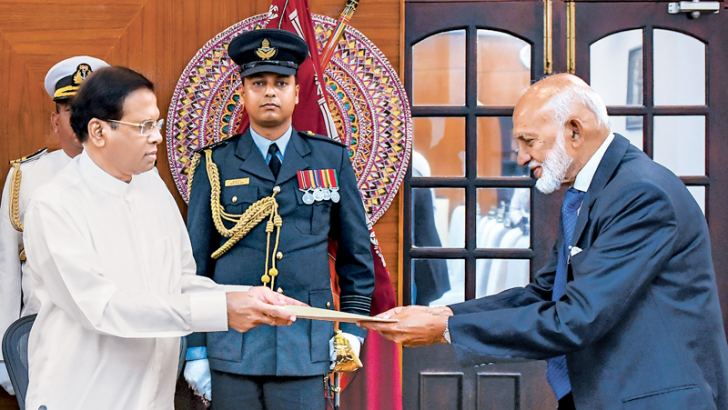 UPFA MP A..H..M.. Fowzie was sworn in as National Unity, Co-existence and Muslim Religious Affairs State Minister before President Maithripala Sirisena yesterday at the Presidential Secretariat. Presidential Secretary Udaya R. Seneviratne was present. Picture by Sudath Silva.