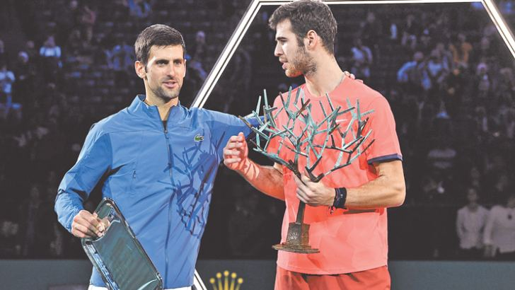 Winner Karen Khachanov (R) and second placed Novak Djokovic with their trophies during the awards ceremony after their men's singles final of the ATP World Tour Masters 1000 on November 4.  AFP
