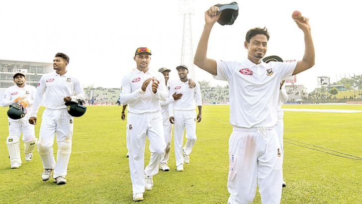 Bangladesh cricketer Taijul Islam (R) acknowledges the crowd as he gets 11 wickets during the third day of the first Test cricket match between Bangladesh and Zimbabwe in Sylhet on November 5. AFP