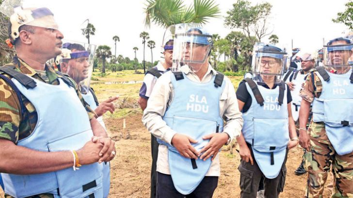 Sri Lanka Army de-miners with their Cambodian counterparts in Muhamalai.