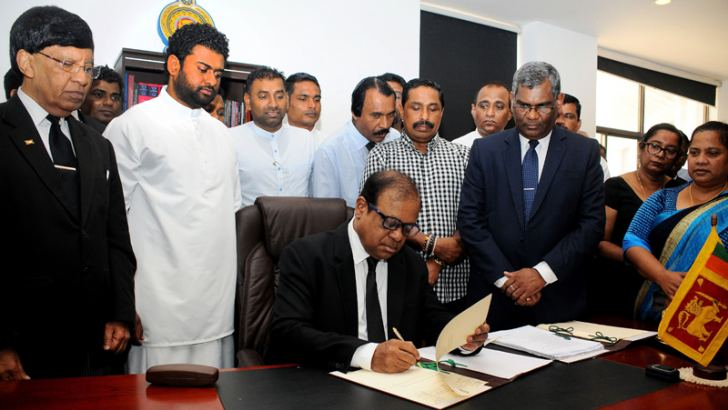 Minister Susil Premajayantha assuming duties. Picture by Wimal Karunathilake.