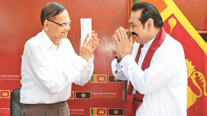 Prime Minister Mahinda Rajapaksa joined the Sri Lanka Podujana Peramuna (SLPP) by obtaining its membership from SLPP Chairman Prof. G. L. Peiris  at the  Prime Minister's residence in Colombo yesterday. Prime Minister Mahinda Rajapaksa greeting SLPP President Professor G. L. Peiris.