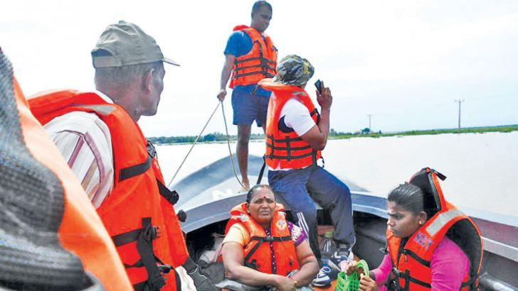 Flood victims being transported by the Navy.