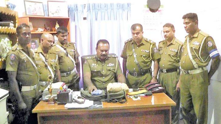 Police officers inspect the cannabis. Picture byVavunia North Group Corr.