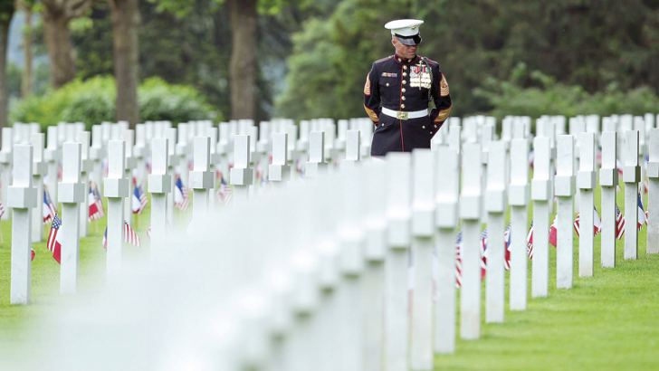 U.S. Marine Sgt. Maj. Darrell Carver of the 6th Marine Regiment walks among the graves of U.S. soldiers killed in World War I at the Aisne-Marne American Cemetery in France on May 27.
