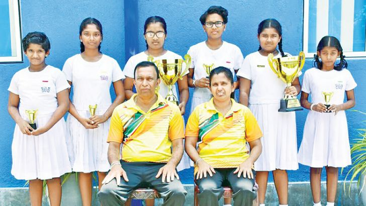 Viharamahadevi Balika Kiribathgoda TT team. Standing (from left): Onaya Jayasuriya, Thinara Hewasingha, Tharindi Perera, Ravindi Balasuriya, Adithi Hansika, Naduni Anupriya.  Seated: Coaches W A Buddhasiri and Namal Gunasekara (both former national players).