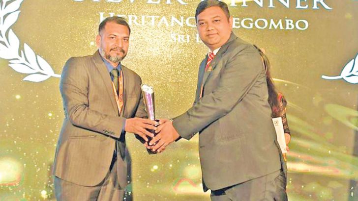 Aitken Spence Hotels Assistant Vice President Arun Raj accepting an award at the SATA 2018 ceremony