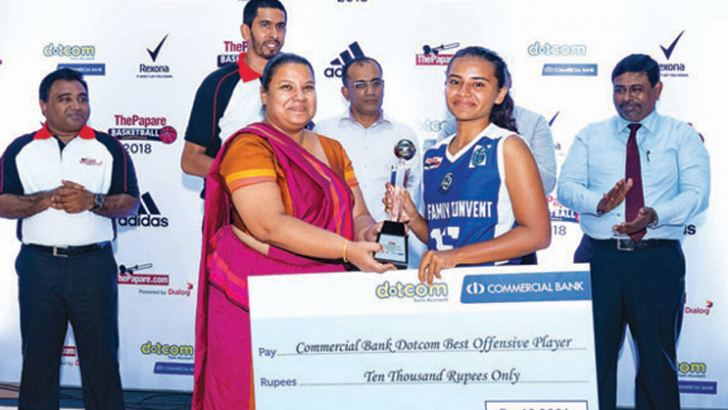 Best Offensive Player Sandrene David of Holy Family Convent Bambalapitiya receiving the award from Commercial Band Senior Marketing Manager Aparna Jagoda.