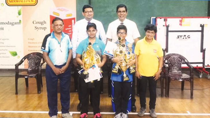 Most outstanding players Dewmeth Weerasena (front row 2nd from right) and Hasara Edirisinghe (front row 2nd from left) with officials and guests