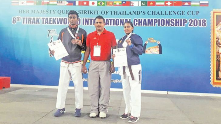 Medal winners with the coach T.V. Priyantha Kumara