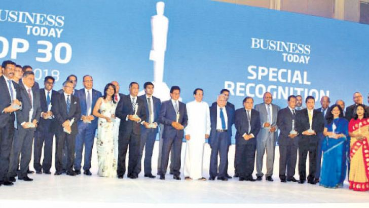 Business Today Top 30 winners and special award recipients with President Maithripala Sirisena at the event. Pix: Sudath Malaweera