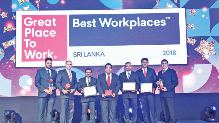 Wajira Senanayake, HR Specialist, Anton Perera, Finance Director, Tharaka De Silva, Head of Human Resources, Dimithri Perera, Country Manager, Sugath Jayawickrama, Operations Director, Vajira Bandara, Head of IT and Mario De Silva, Commercial Director of DHL with their awards
