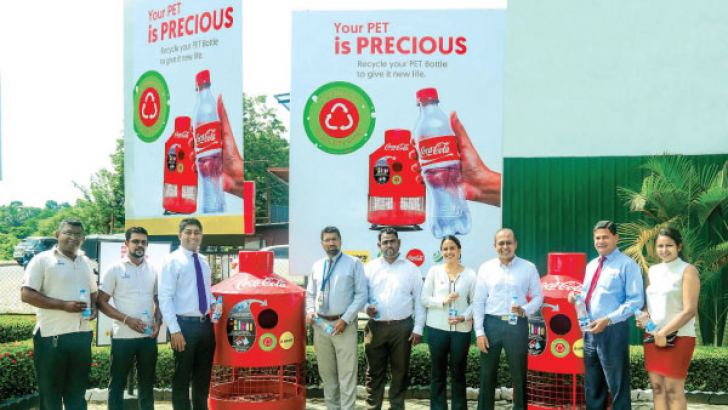 Mahesh Weerasena  CEO LAUGFS Petroleum, Charaka Perera General Manager LAUGFS Petroleum, Lakshan Madurasinghe Country Public Affairs, Communications and Sustainability Manager Coca-Cola Beverages Sri Lanka,  Priyantha Ranasinghe  Country Human Resources Manager Coca-Cola and their colleagues at the 'Give Back Life' PET plastic collection and recycling project launch at LAUGFS Petroleum Koswatte