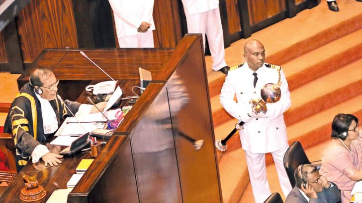 Serjeant-at-Arms Narendra Fernando holding the Mace while in session yesterday. Picture by Rukmal Gamage.