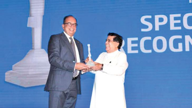 Sunshine's Group Managing Director, Vish Govindasamy receives award from Minister Nimal Siripala De Silva