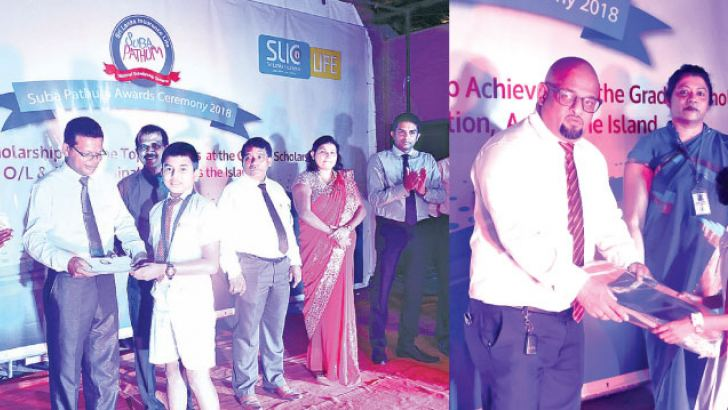 Students receiving their scholarships from officials of SLIC. Press Release