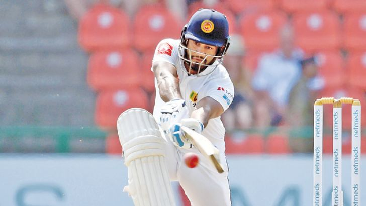Sri Lanka opener Dimuth Karunaratne plays a sweep shot in his knock of 63.  AFP