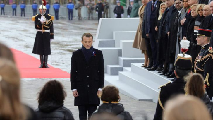 French President Emmanuel Macron pays his respects by the Tomb of the Unknown Soldier during in a ceremony at the Arc de Triomphe last Sunday to mark the centennial of the Armistice that ended World War I. US President Donald Trump, Russian President Vladimir Putin and German Chancellor Angela Merkel were among the world leaders in attendance.  - AFP
