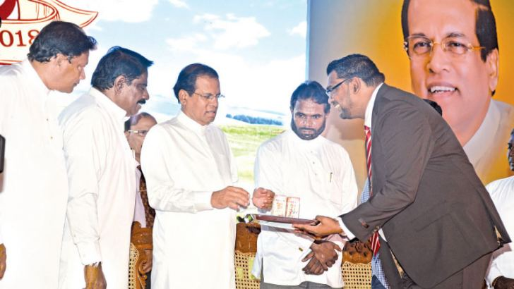 President Maithripala Sirisena inspecting some of the new products looked on by Minister Vijith  Vijithamuni De Soyza, and other officials. Picture by Sudath Malaweera
