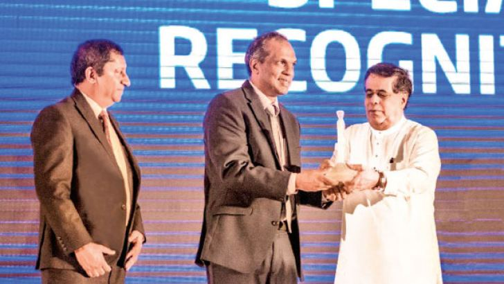 Cecil Perera, Chairman and Rajiv Cassie Chitty, Chief Operating Officer receive the award