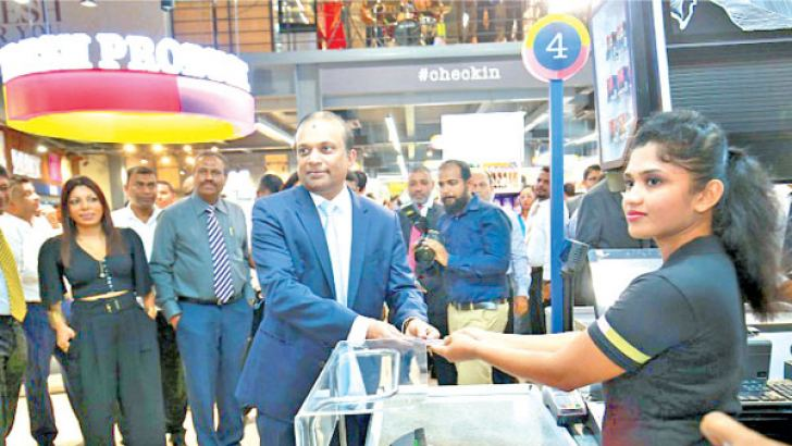Ashok Pathirage, Chairman and Managing Director, Softlogic PLC making the first purchase