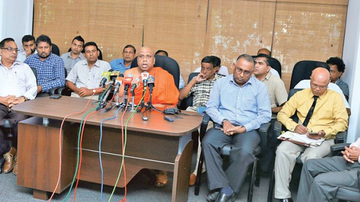 A group of University academics held a media briefing yesterday. Kelaniya University Lecturer Ven. Kapugollawe Ananda Thera speaking on the occasion. Picture by Malan Karunaratne