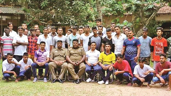 Participants at the rehabiliation programme with police officers.