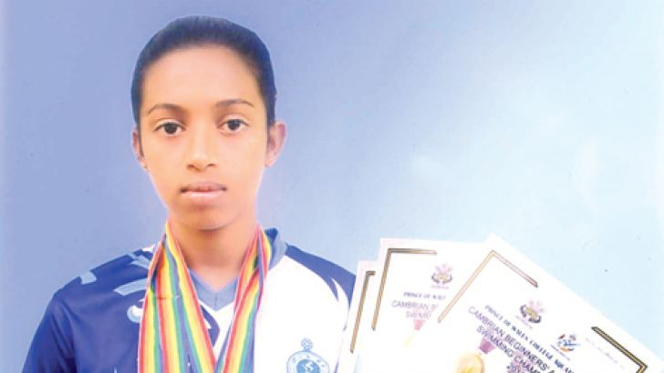 Warsha with her Gold Medal and certificates.  (Picture by Kalutara Central Special Corr)