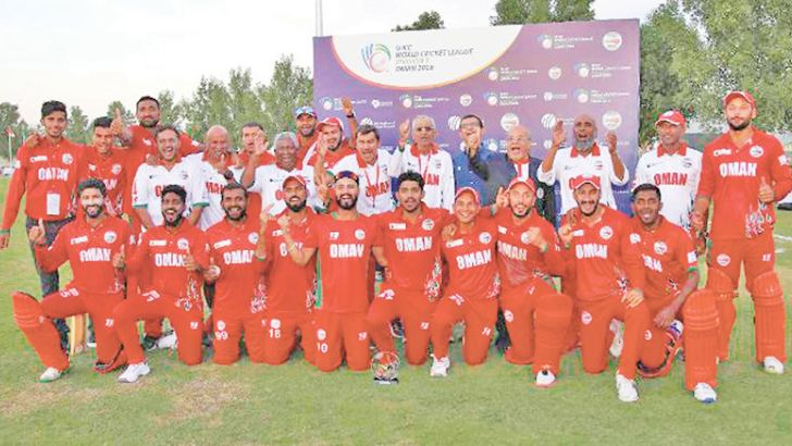 The Oman Cricket team coached by former Sri Lanka captain Duleep Mendis (standing fifth from left).