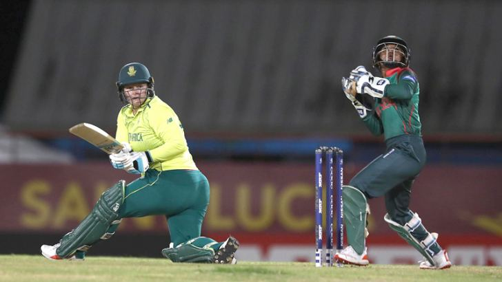 Lizelle Lee of South Africa Women sweeps the ball towards the boundary in their ICC World Women's T20 match against Bangladesh at St. Lucia.